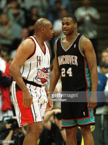 Forward Charles Barkley of the Houston Rockets and forward Othella Harringtonin of the Vancouver Grizzlies in action during the final game of the...