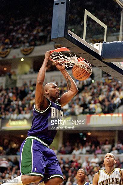 Glenn Robinson of the Milwaukee Bucks makes a slam dunk during the NBA Eastern Conference Playoffs Round One Game against the Indiana Pacers at the...