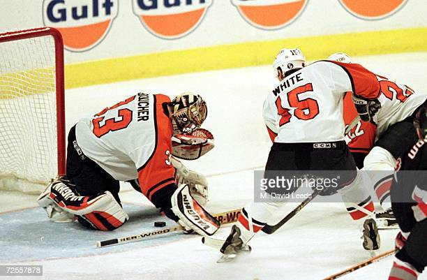Goalie Brian Boucher of the Philadelphia Flyers makes a save as center Peter White lends a hand during the Flyers'' 52 victory over the Buffalo...