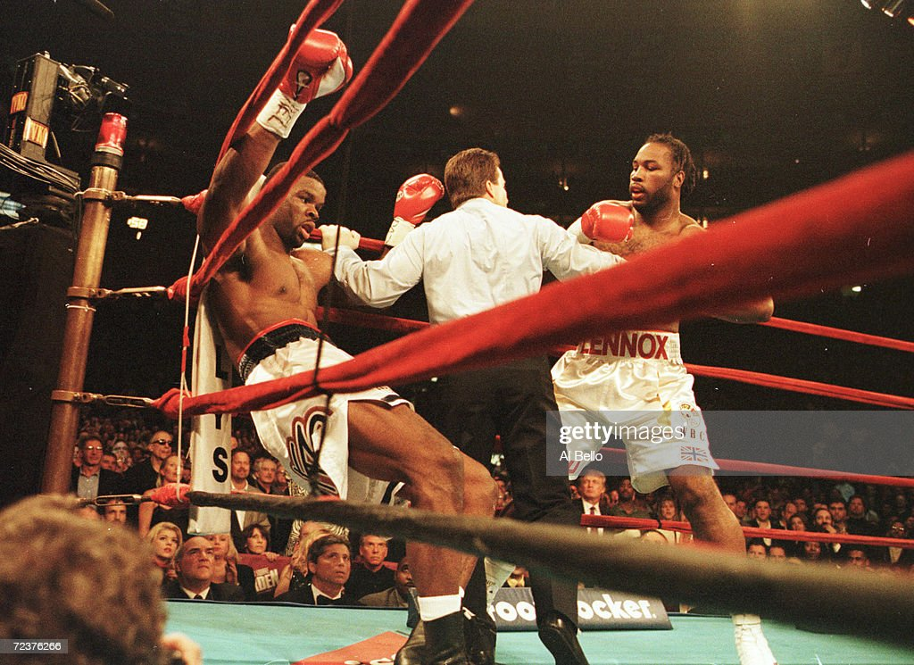 http://media.gettyimages.com/photos/apr-2000-heavyweight-champion-lennox-lewis-gets-michael-grant-against-picture-id72376266