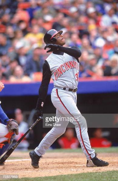 Ken Griffey Jr #30 of the Cincinnati Reds watches the ball after his swing during the game against the New York Mets at Shea Stadium in Flushing New...