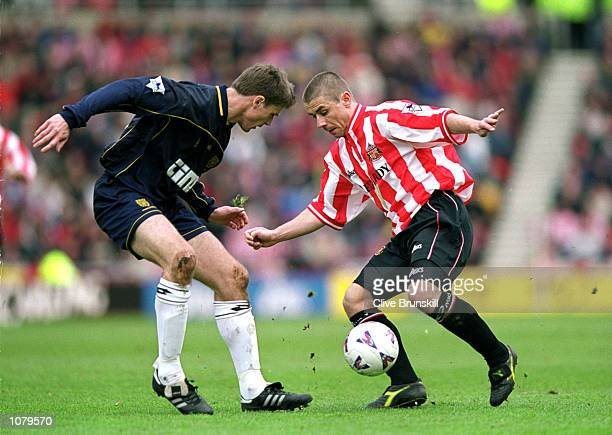 Kevin Phillips of Sunderland takes on Trond Anderson of Wimbledon during the FA Carling Premiership match at the Stadium of Light in Sunderland...