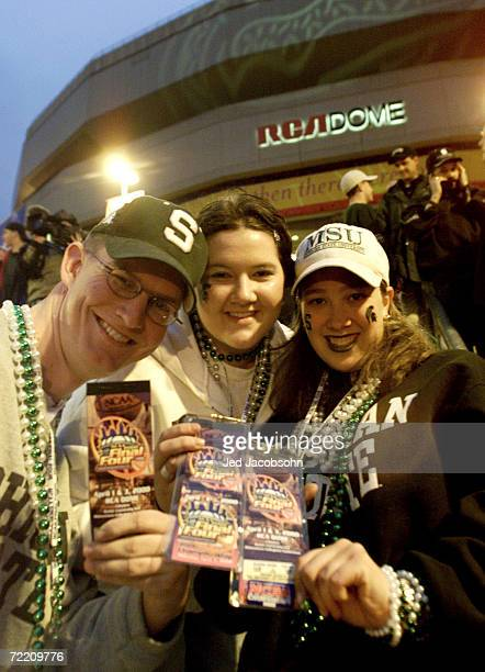 Michigan State fans show off their tickets outside the RCA Dome before the start of the final round of the NCAA Men''s Final Four between Michigan...