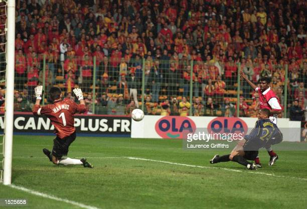 Nwankwo Kanu of Arsenal scores their second goal on the night during the UEFA Cup Semi Final Second Leg game between Lens and Arsenal at the Felix...