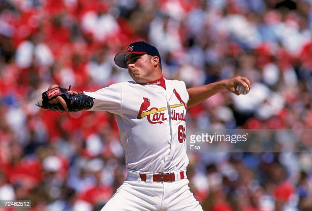 Rick Ankiel of the St Louis Cardinals winds back to pitch the ball during a game against the Milwaukee Brewers at the Bush Stadium in St Louis...