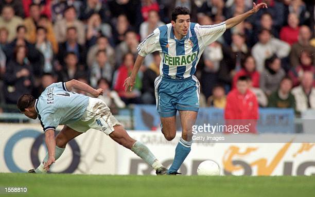 Roy Makaay of Deportivo La Coruna beats Francisco Caceres of Celta Vigo during the Spanish Primera Liga match at the Estadio Balaidos Vigo Spain...