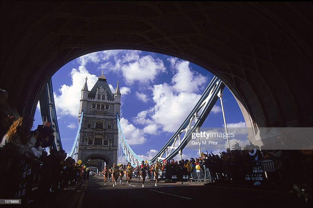 Runners cross Tower Bridge in the 2000 Flora London Marathon in London, England. Mandatory Credit: Gary M. Prior/Allsport