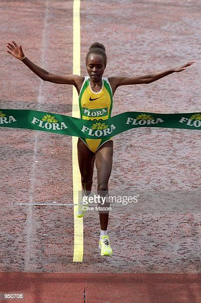 Tegla Lorupe of Kenya takes the tape to win the Flora London Marathon in London England Mandatory Credit Clive Mason /Allsport