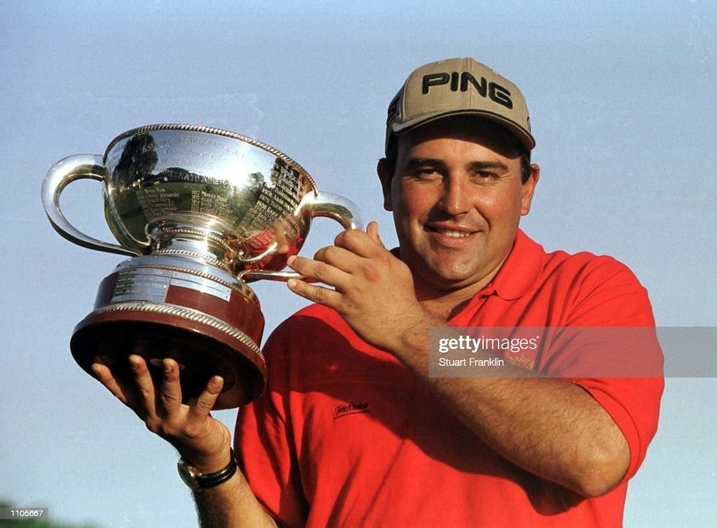 Angel Cabrera poses with the trophy after claiming victory after the final round of the Argentina Open Golf Championships at the Jockey Club in...