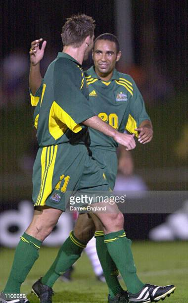 Archie Thompson and David Zdrilic of the Socceroos celebrate scoring a goal against American Samoa during the Oceania group one World Cup qualifier...