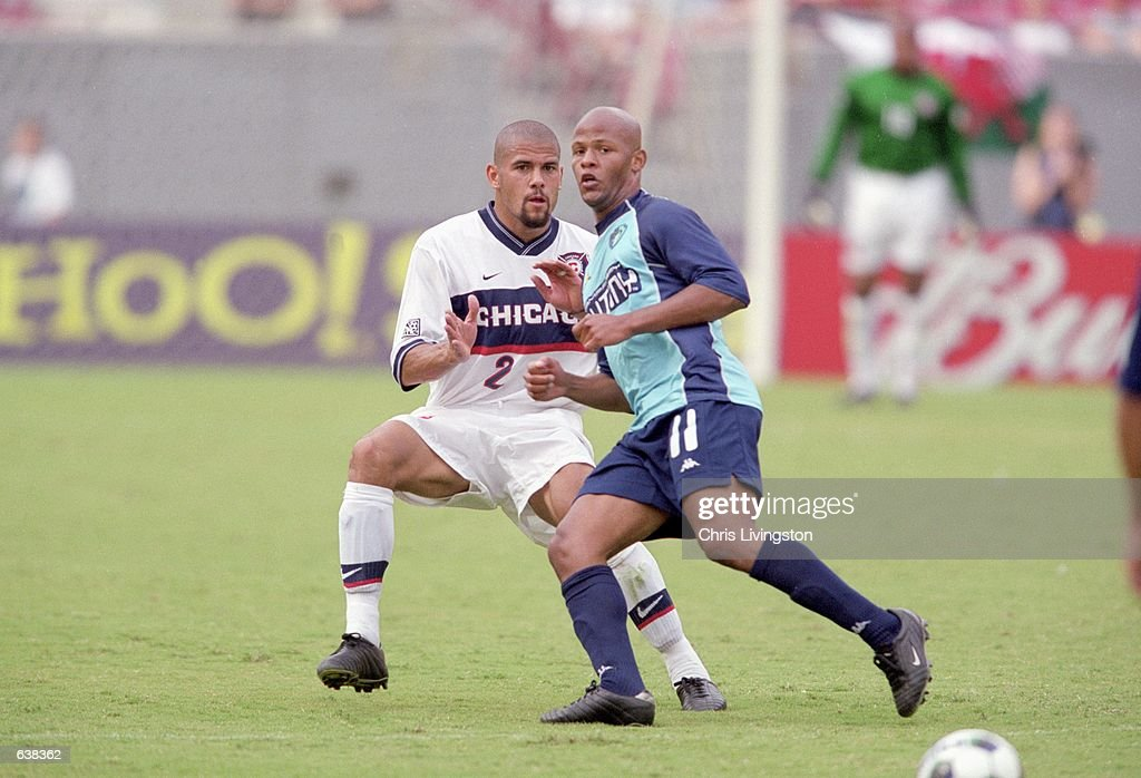 C. J. Brown #2 of the Chicago Fire fights for control of the ball against Ali Curtis #11 of the Tampa Bay Mutiny during the game at the Raymond James Stadium in Tampa, Florida. The Fire defeated the Mutiny 1-0.Mandatory Credit: Chris Livingston /Allsport