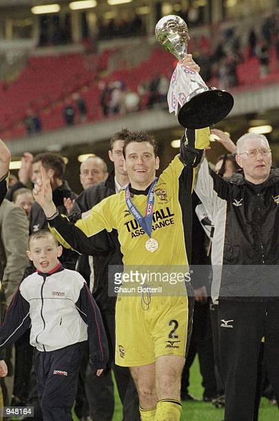 Captain Matt Carragher of Port Vale lifts the trophy after the LDV Vans Trophy Final against Brentford played at the Millennium Stadium in Cardiff...