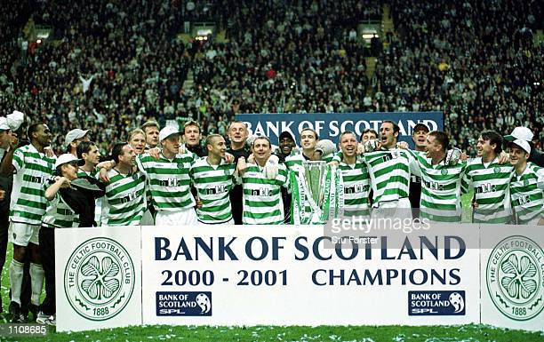 Celtic celebrate with the trophy after winning the Bank of Scotland Premier League Championship at Celtic Park Glasgow Mandatory Credit Stu...