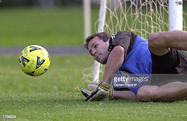 Clint Bolton of the Australian Socceroos makes a save during training at the Coffs Harbour Showground in Coffs Harbour Australia The Socceroos are...