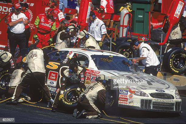 Dale Jarrett who drives a Ford Taurus for Robert Yates Racing pulls in for a pit stop during the Virginia 500 part of the NASCAR Winston Cup...