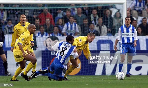 Djalminha of Deportivo La Coruna tries to tackle David Batty of Leeds during the UEFA Champions League Quarterfinal 2nd Leg between Deportivo La...