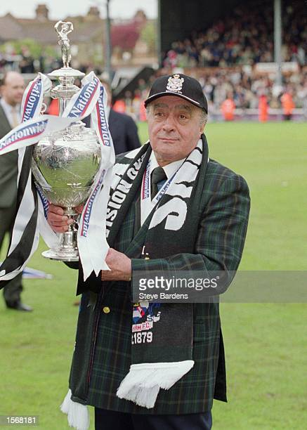 Fulham chairman Mohamed AlFayed lifts the league title up after the Nationwide League Division One match against Wimbledon played at Craven Cottage...