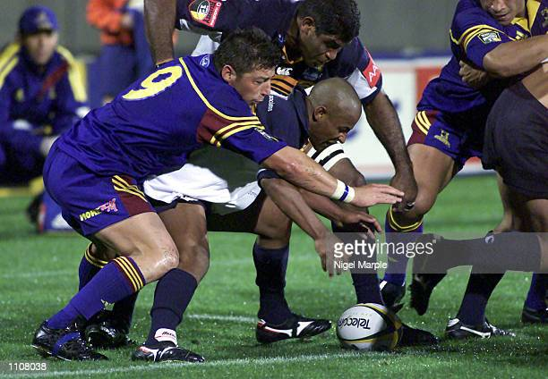George Gregan of the Brumbies is about to be tackled by Bryon Kelleher of the Highlanders during the Super 12 clash between the Highlanders and the...