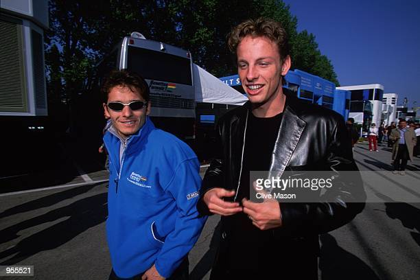 Giancarlo Fisichella of Italy and Jenson Button of Great Britain and the Benetton team relax before the Formula One San Marino Grand Prix at Imola...