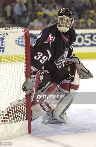 Goaltender Dominik Hasek of the Buffalo Sabres is left stickless as he defends the goal against the Pittsburgh Penguins during game three of the...
