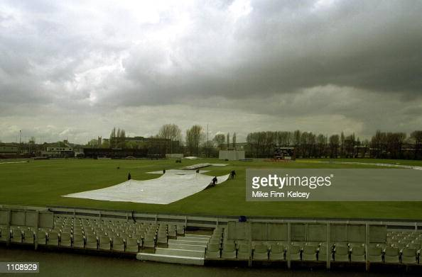 Groundmen at Derbyshire County Cricket Club bring on the covers as rain delays the start of play in the CricInfo County Championship match between...