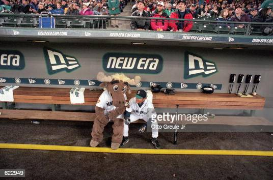 Ichiro Suzuki of the Seattle Mariners hangs with the Mascot in the dug out during the game against the Oakland Athletics at Safco Field in Seattle...