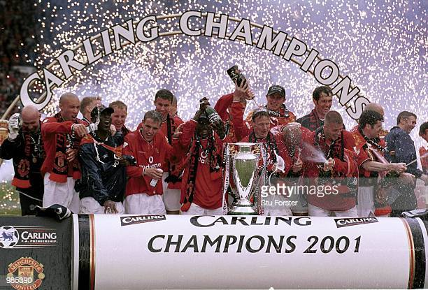 Manchester United celebrate winning the FA Carling Premiership trophy after the match between Manchester United and Derby County at Old Trafford...