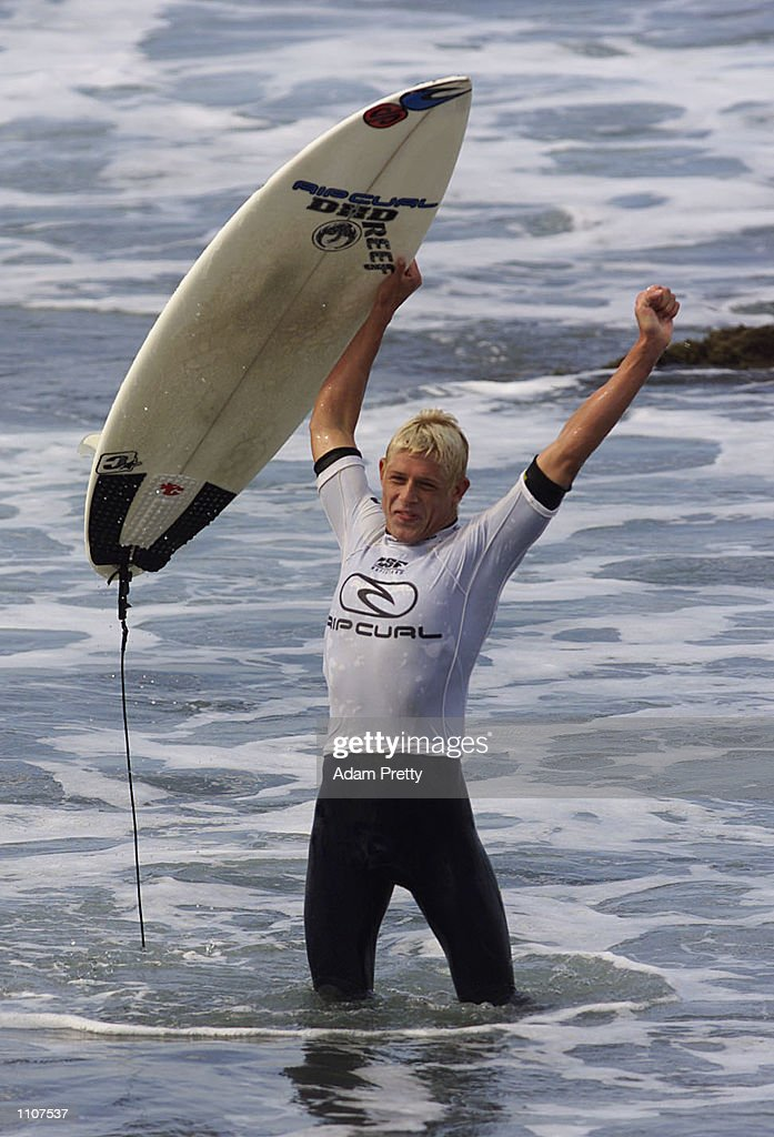 Mick Fanning of Australia celebrates after defeating Danny Wills of Australia in the final of the Rip Curl Pro Surfing Contest Bells Beach Torquay...