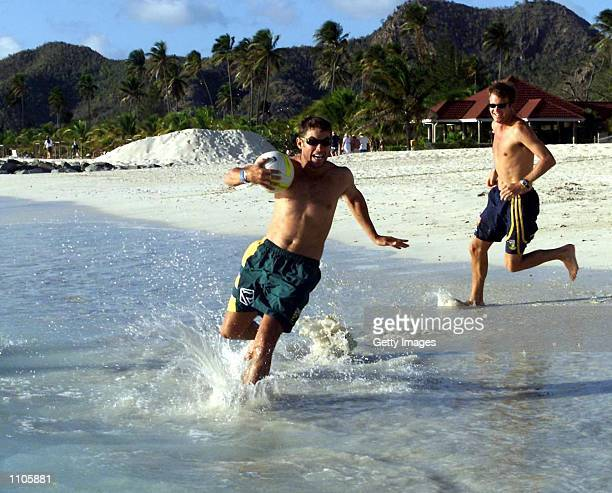 Neil McKenzie is chased by Corrie van Zyl while playing beach rugby at Jolly Harbour Antigua during the South African tour to the West Indies DIGITAL...