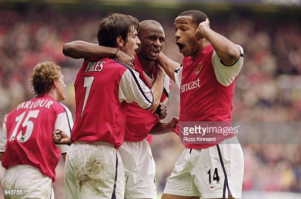 Patrick Vieira celebrates scoring the equalising goal with teammates Robert Pires and Thierry Henry all of Arsenal during the AXA sponsored FA Cup...