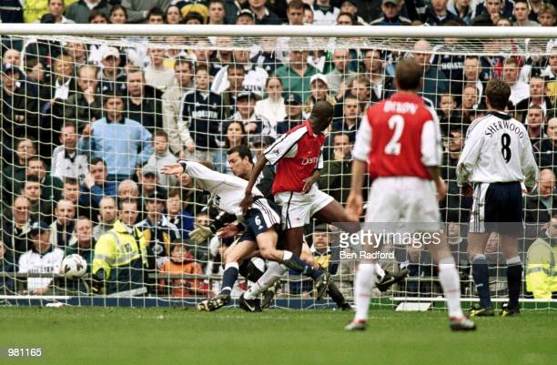 Patrick Vieira scores Arsenals first goal during the AXA FA Cup SemiFinal between Arsenal and Tottenham Hotspur at Old Trafford Manchester Mandatory...