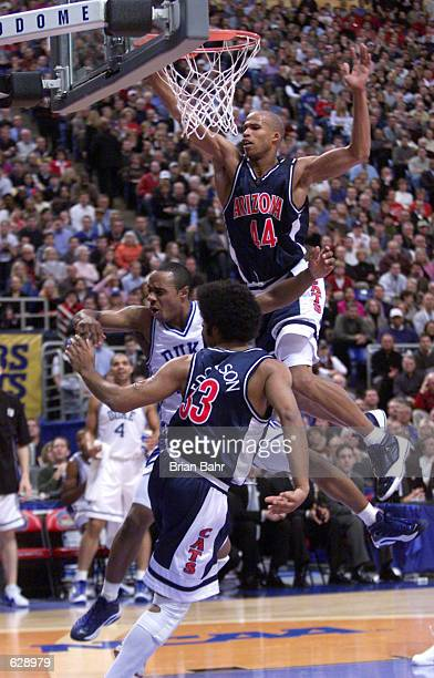 Richard Jefferson of Arizona and Jason Williams of Duke get tangled up on a play to the basket during the NCAA National Championship Game of the...