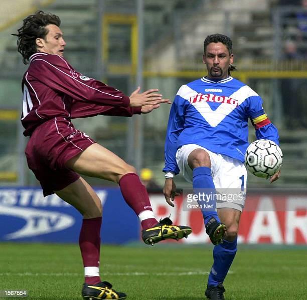 Roberto Baggio of Brescia and Ezio Brevi of Reggina in action during the Serie A 25th Round League match between Brescia and Reggina played at the...