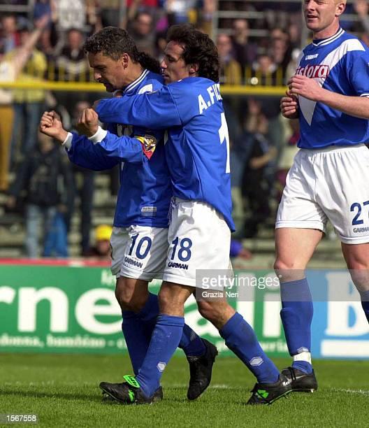 Roberto Baggio of Brescia celebrates a goal with Antonio Filippini during the Serie A 25th Round League match between Brescia and Reggina played at...