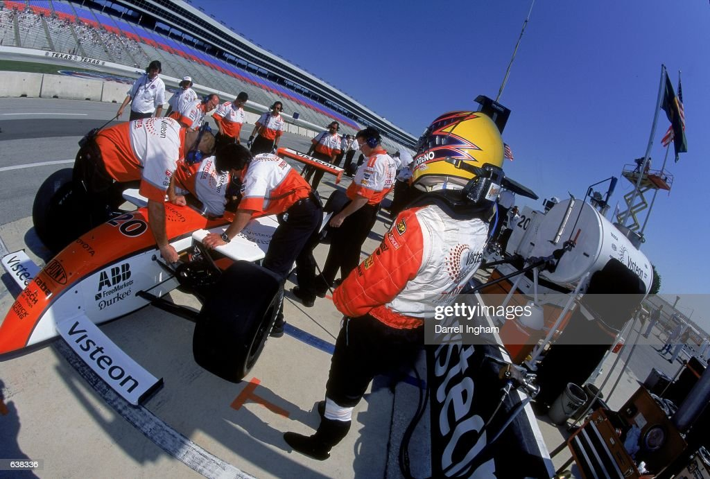 Roberto Moreno of Brazil who drives a Toyota Reynard for Patrick Racing watches his car while testing the hans head and neck support system during the Firestone Firehawk 600, part of the CART FedEx Championship Series at the Texas Motor Speedway in Fort Worth, Texas.Mandatory Credit: Darrell Ingham /Allsport