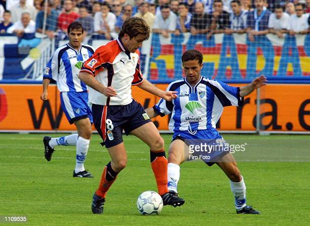 Sandro of Malaga and Tomic of Oviedo in action during a Primera Liga match played between Malaga and Oviedo at the La Rosaleda Stadium DIGITAL IMAGE...