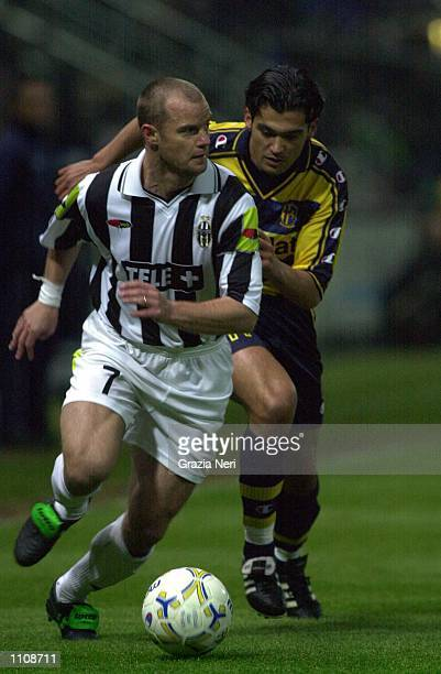 Sergio Conceciao of Parma pursues Gianluca Pessotto of Juventus during the Parma v Juventus Serie A match played at the Ennio Tardini Parma DIGITAL...