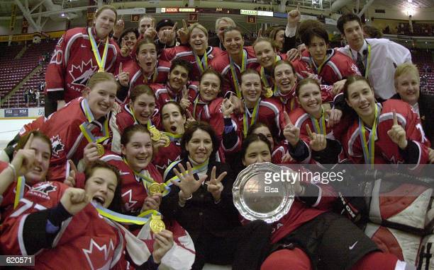 Team Canada pose for a group shot after they won their seventh Women's World Hockey Championship game at Mariucci Arena in Minneapolis Minnesota...