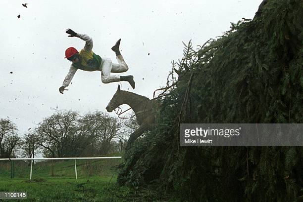 Tom Doyle of Ireland parts company with his mount Esprit de Cotte at the 11th fence during The Martell Grand National at Aintree Leverpool Mandatory...