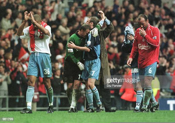 Wycombe players leave the pitch after the AXA FA Cup Semi Final between Liverpool and Wycombe Wanderers at Villa Park Birmingham Mandatory Credit Stu...