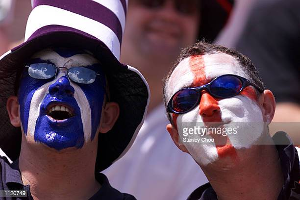 A Scotish fan and an English fan gets together to support England during the Singapore Sevens between England and Chinese Taipei at the IRB World...