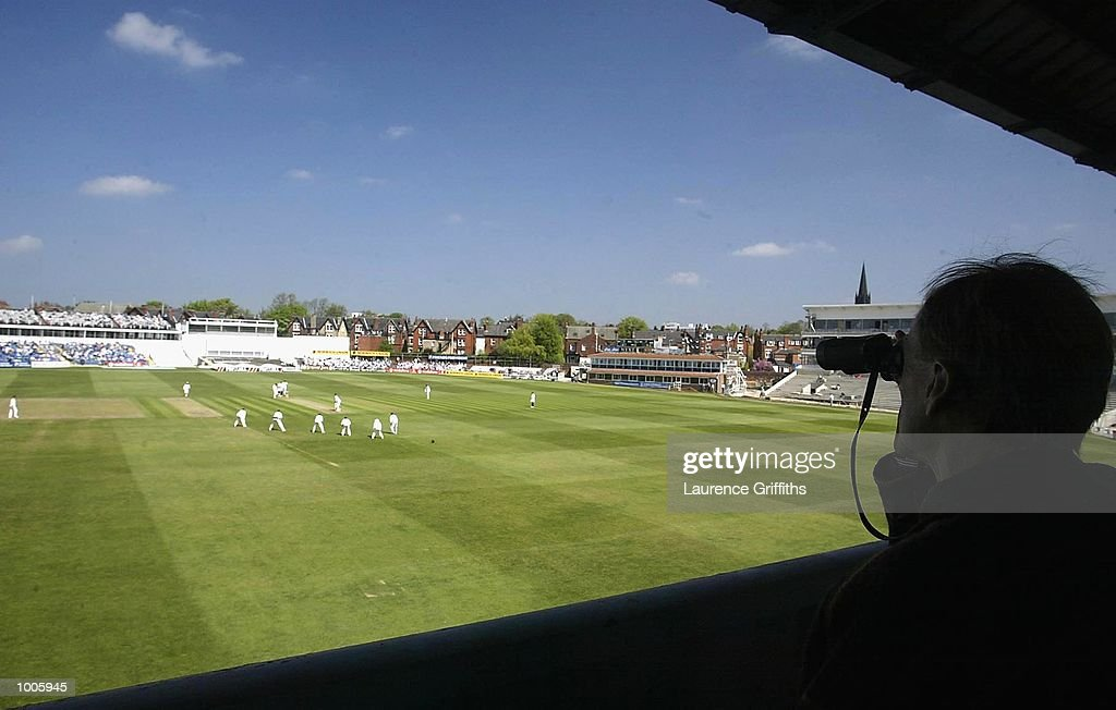 A spectator views the game from the shade of the Rugby Stand End during the Frizzell County Championship game between Yorkshire and Surrey at Headingley, Leeds. DIGITAL IMAGE Mandatory Credit: Laurence Griffiths/Getty Images