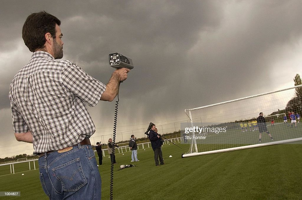 A speed gun is used to measure the speed of the shots of some members of the media during a try out with the new Nike Geo Merlin Vapor ball at a Press Day to launch the Nike World Cup Range at Arsenal's training ground at Colney Hatch, London. DIGITAL IMAGE. Mandatory Credit: Stu Forster/Getty Images