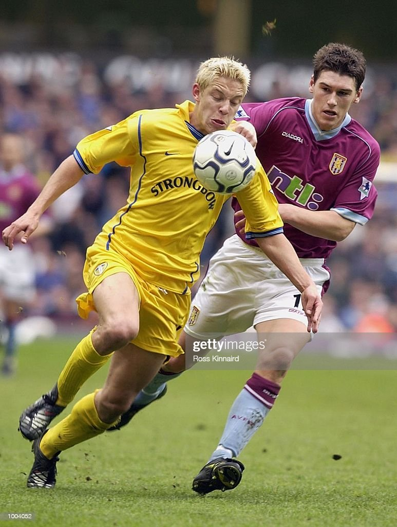 Alan Smith of Leeds gets away from Gareth Barry of Villa during the FA Barclaycard Premiership match between Aston Villa and Leeds United at Villa Park, Birmingham. DIGITAL IMAGE. Mandatory Credit: Ross Kinnaird/Getty Images