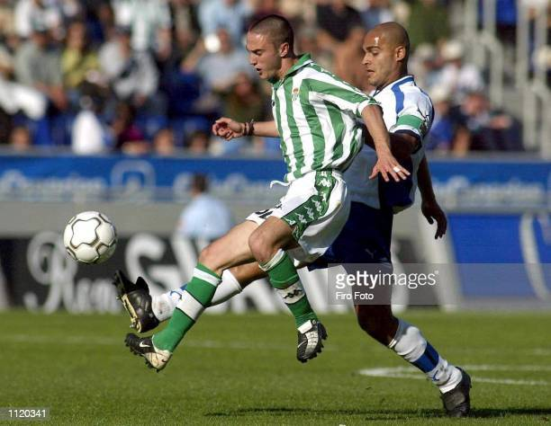 Alexis Suarez of Tenerife and Dani of Real Betis in action during the Primera Liga match between Tenerife and Real Betis played at the Heliodoro...
