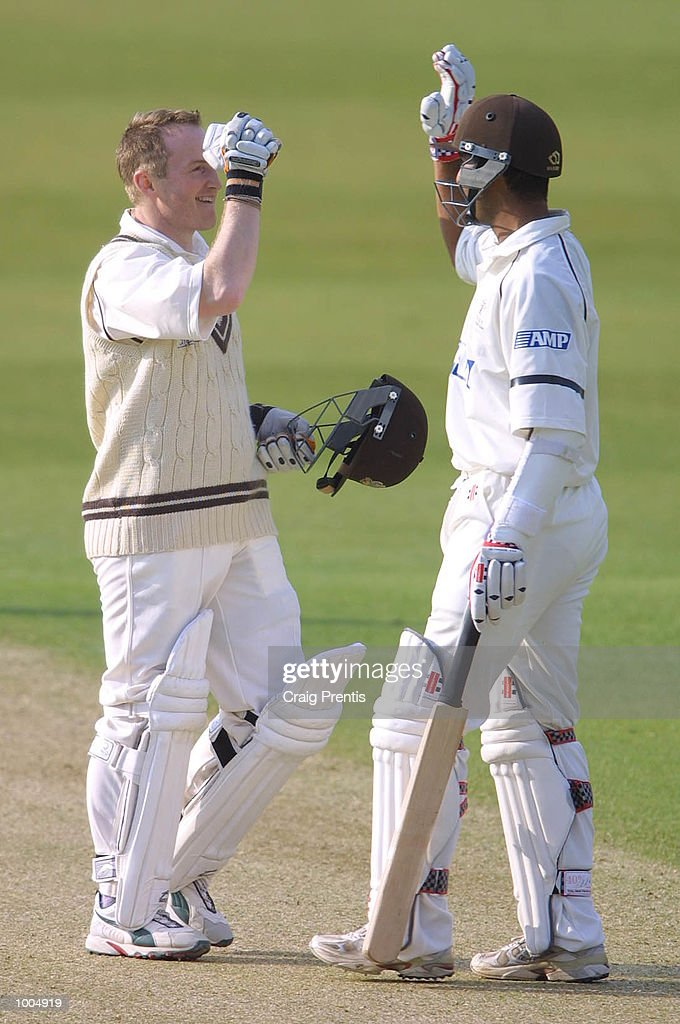Ali Brown of Surrey [left] celebrates scoring a century with Nadeem Shahid on the first day of the Frizzell County Championship match between Surrey and Sussex at the Oval, London. DIGITAL IMAGE Mandatory Credit: Craig Prentis/Getty Images