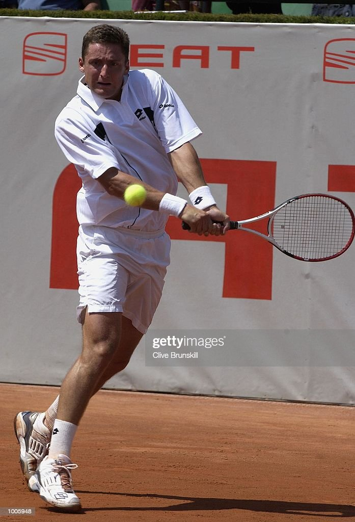 Andrea Gaudenzi of Italy plays a backhand during his second round match against Carlos Moya of Spain during the Open Seat Godo 2002 held in Barcelona, Spain. DIGITAL IMAGE Mandatory Credit: Clive Brunskill/Getty Images
