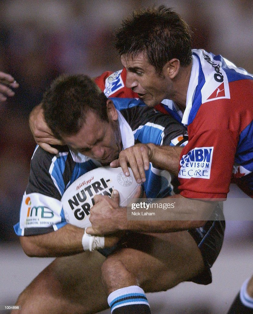 Andrew Johns #7 of the Knights tackles brother Matthew Johns #6 of the Sharks during the NRL match between the Newcastle Knights and the Sharks held at Energy Australia Stadium, Newcastle, Australia. Mandatory Credit: Nick Laham/Getty Images