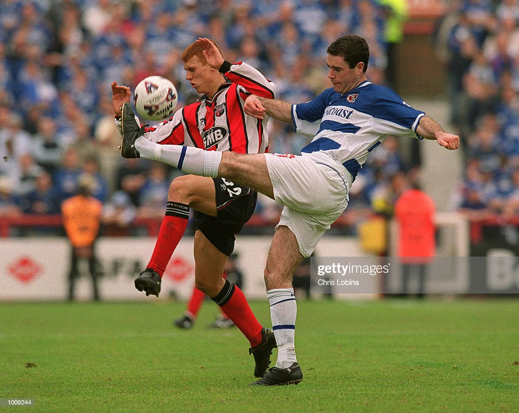 Andy Hughes of Reading clears the ball from Steve Sidwell of Brentford during the Nationwide Division Two match between Brentford and Reading at Griffin Park, Brentford, London. Mandatory Credit: Chris Lobina/Getty Images