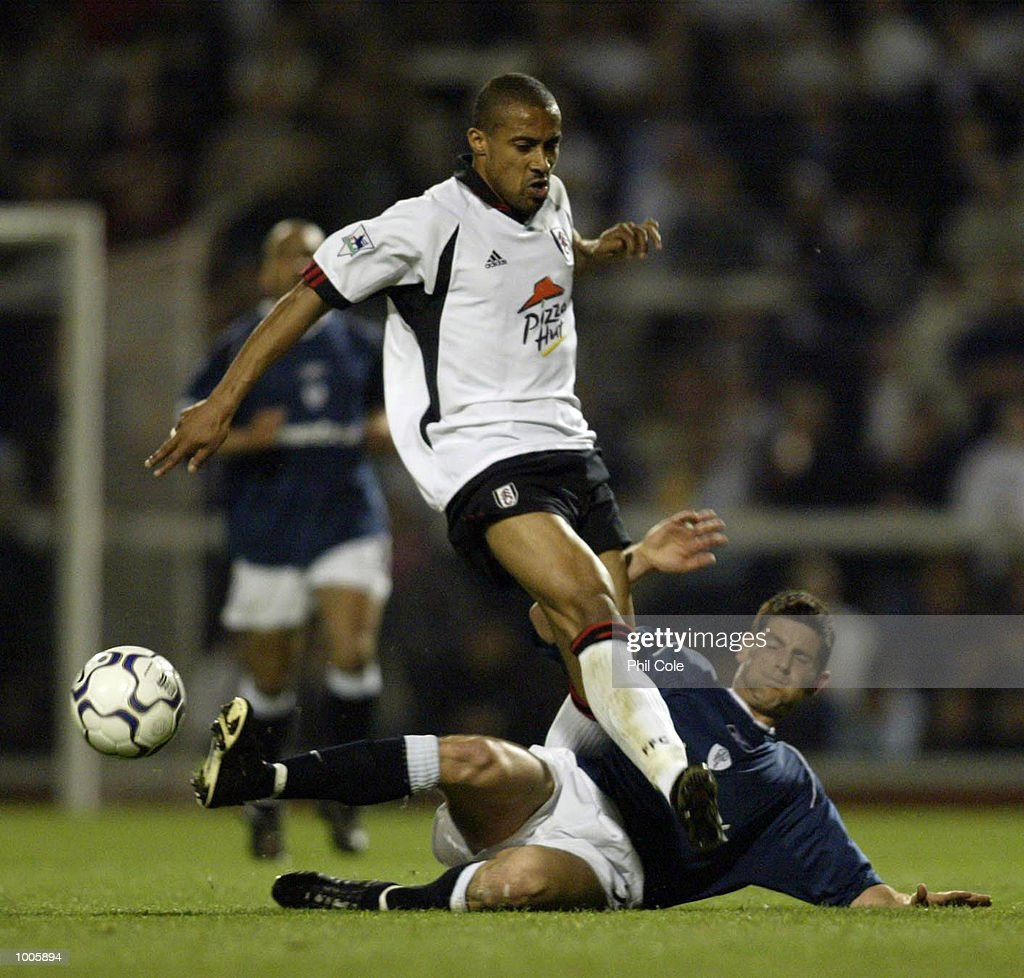 Anthony Barness of Bolton Wanderers tries to tackle Steve Marlet of Fulham during the FA Barclaycard Premiership match between Fulham and Bolton Wanderers at Craven Cottage, London. DIGITAL IMAGE Mandatory Credit: Phil Cole/Getty Images